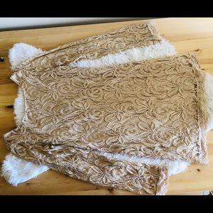 Tan lace/mesh fabric dress.